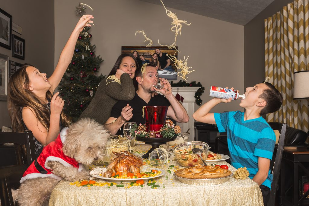 family enjoying thanksigiving dinner together