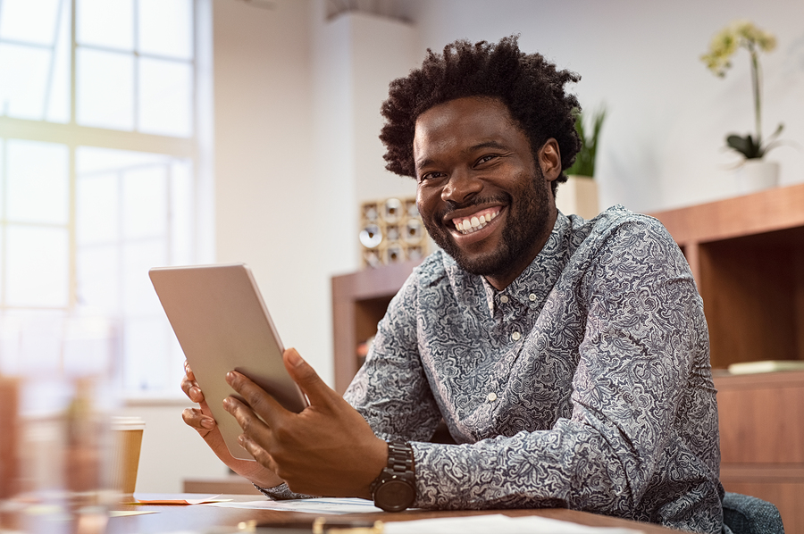 man smiley into camera and happy that he is learning a new language