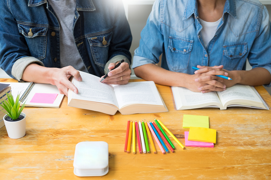 students-studying-spanish-with-books