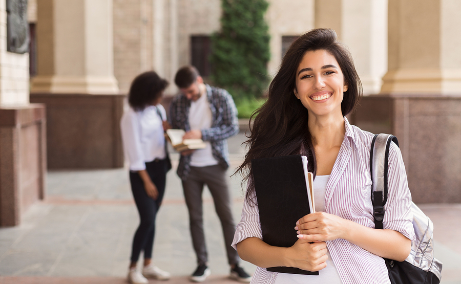 happy-year-abroad-student-at-university-holding-files