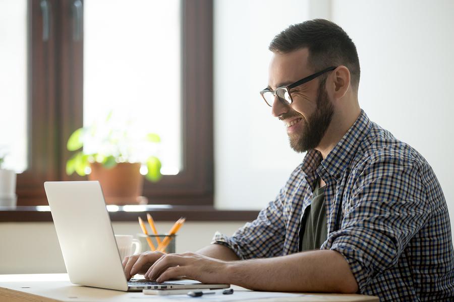 happy-man-working-on-laptop