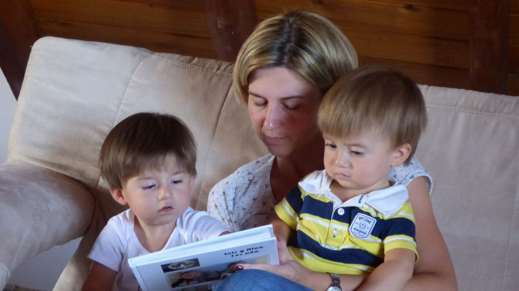 judith with her children reading a story together