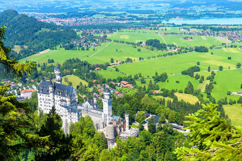 andscape with Neuschwanstein castle taken from above. Scenic panorama in summer.