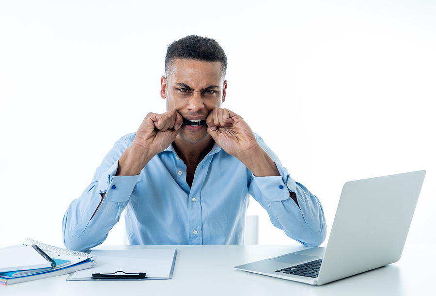 Overwhelmed desperate attractive businessman with too much work feeling frustrated and nervous in distress. Overtime overwork deadline and frustration stress at work. Isolate on white background.