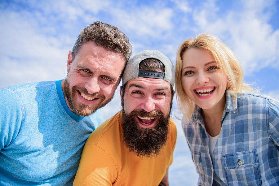 So happy. Enjoying friendship relations. Happy friends smile on cloudy sky. Sensual woman and men happy smiling. Circle of best friends. They have friendship. Group of cheerful people