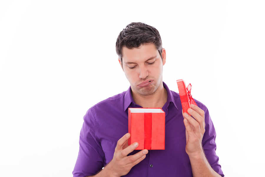 Upset man because of unhappy boring present
