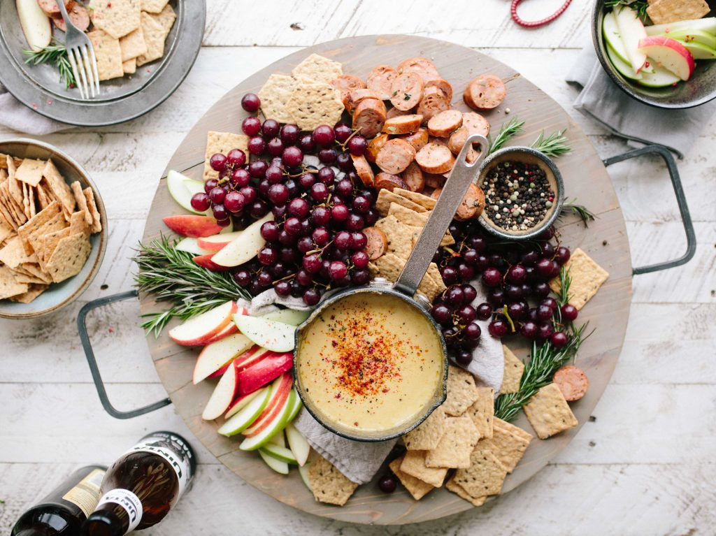 plate full of snacks and nibbles for a party