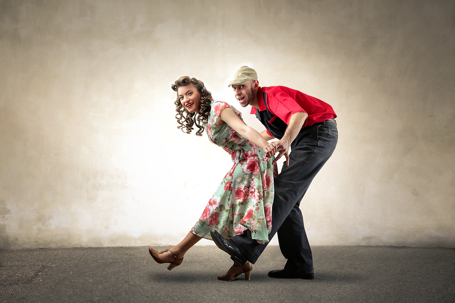 Dancing couple in rockabilly and vintage clothes