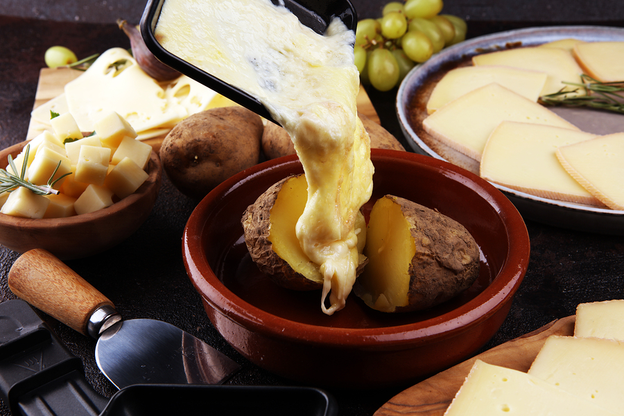 raclette cheese melted served in individual skillets. Very delicious swiss raclette which is eaten in Germany at new year