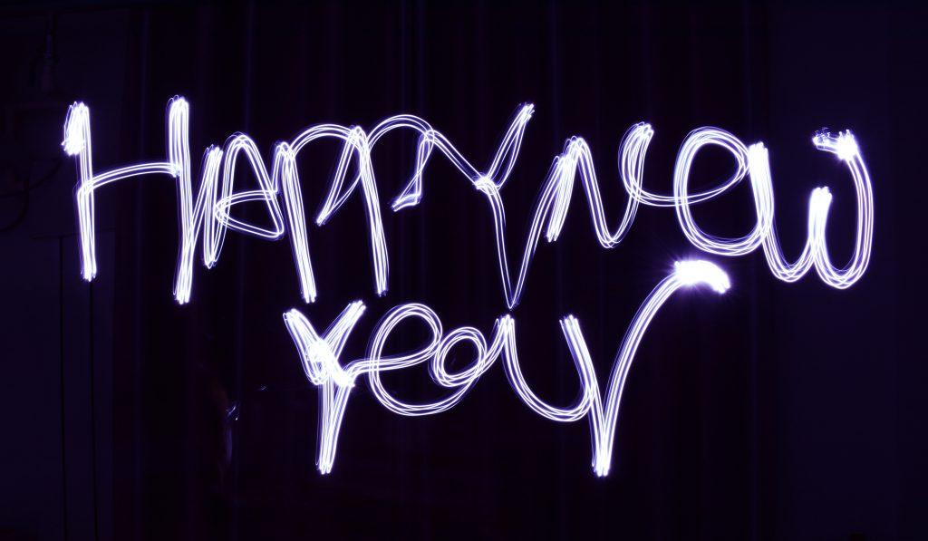 happy new year written in blue