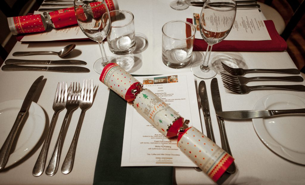 christmas dinner table with a cracker and food menu