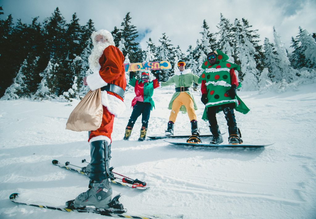 santa and his elfs on skiis