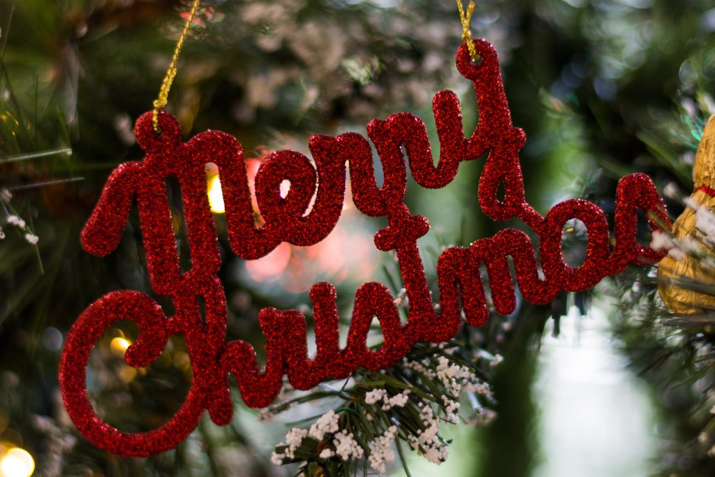 A red merry christmas sign written in italics