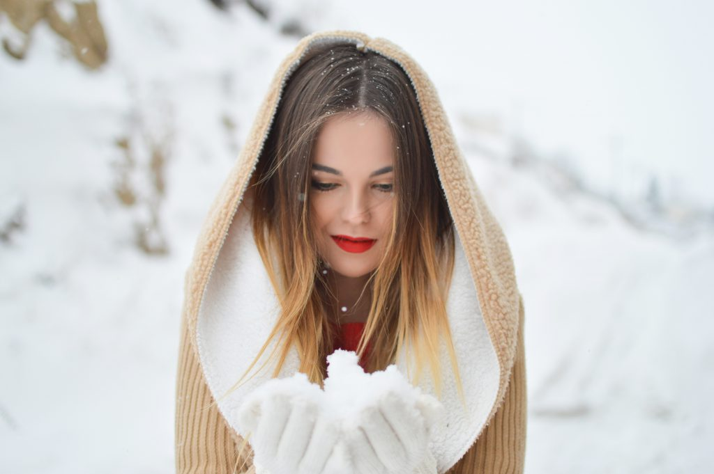 woman enjoying the snow and a white christmas