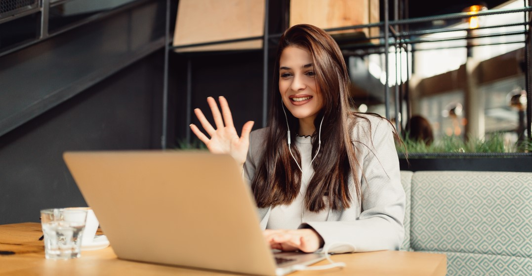 woman on her laptop starting the habit of language learning