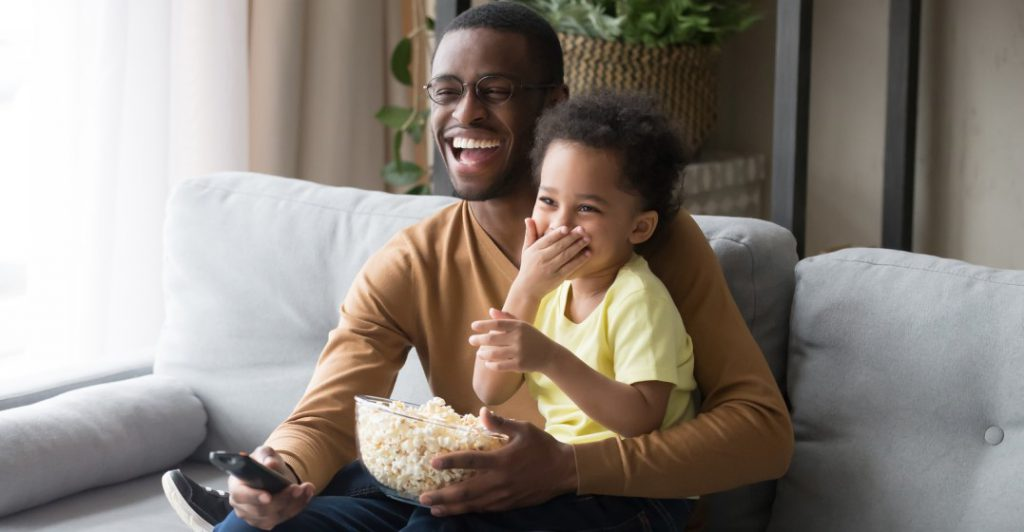 man and son watching movies in french