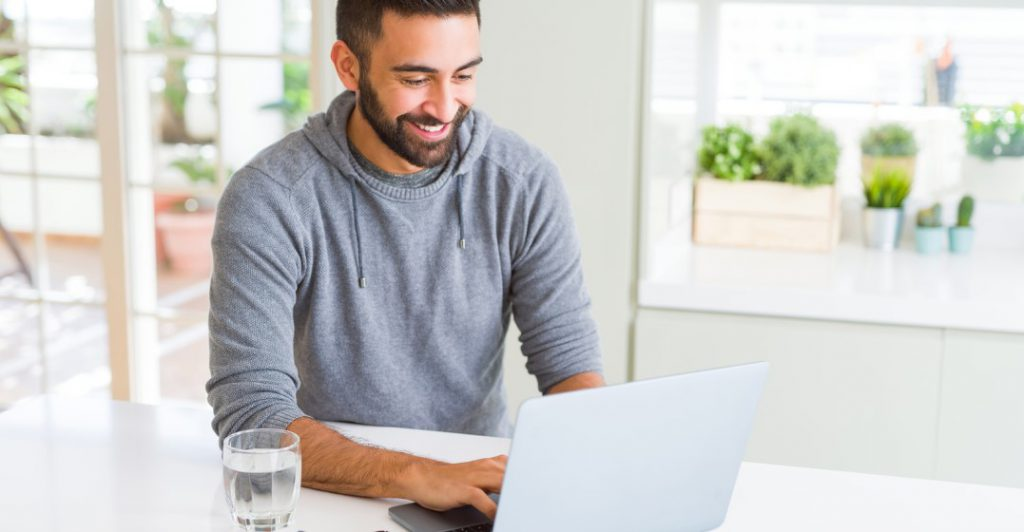 man learning languages online with lingoda using his laptop