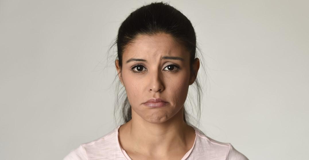 Woman saying sorry in english