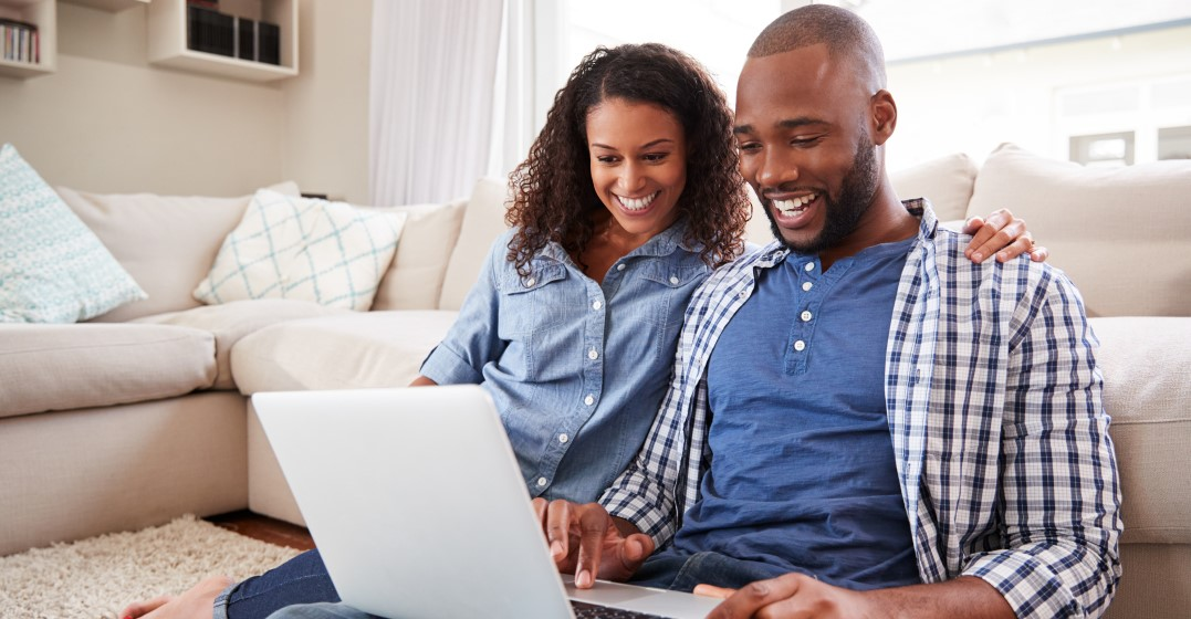 couple saying i love you together as they look up things on the internet
