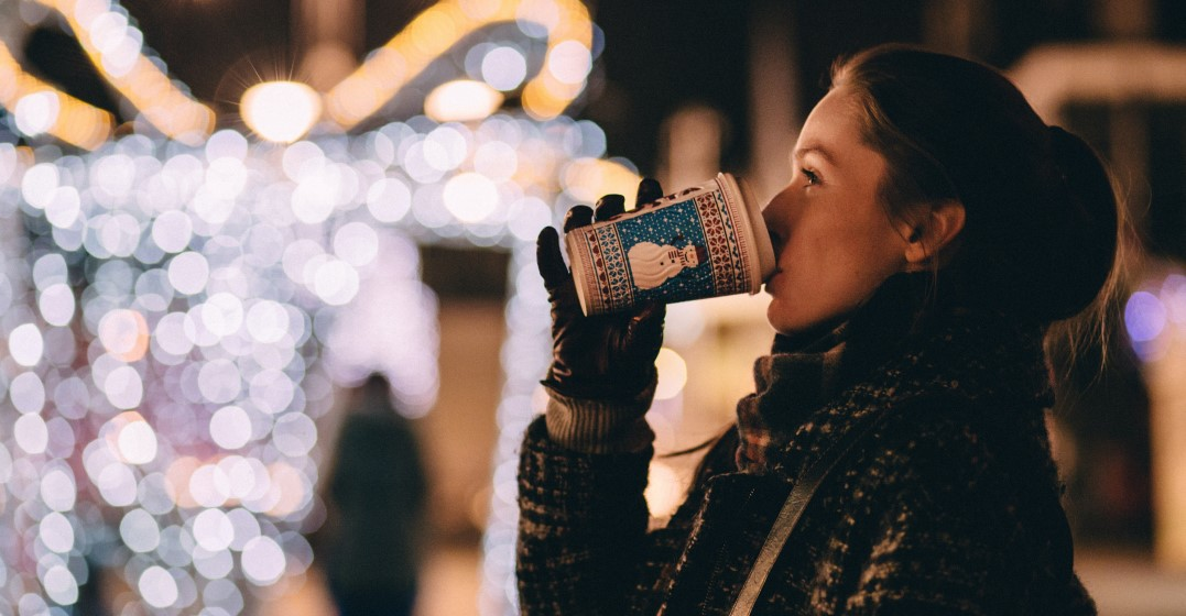 woman drinking hot chocolate and celebrating christmas