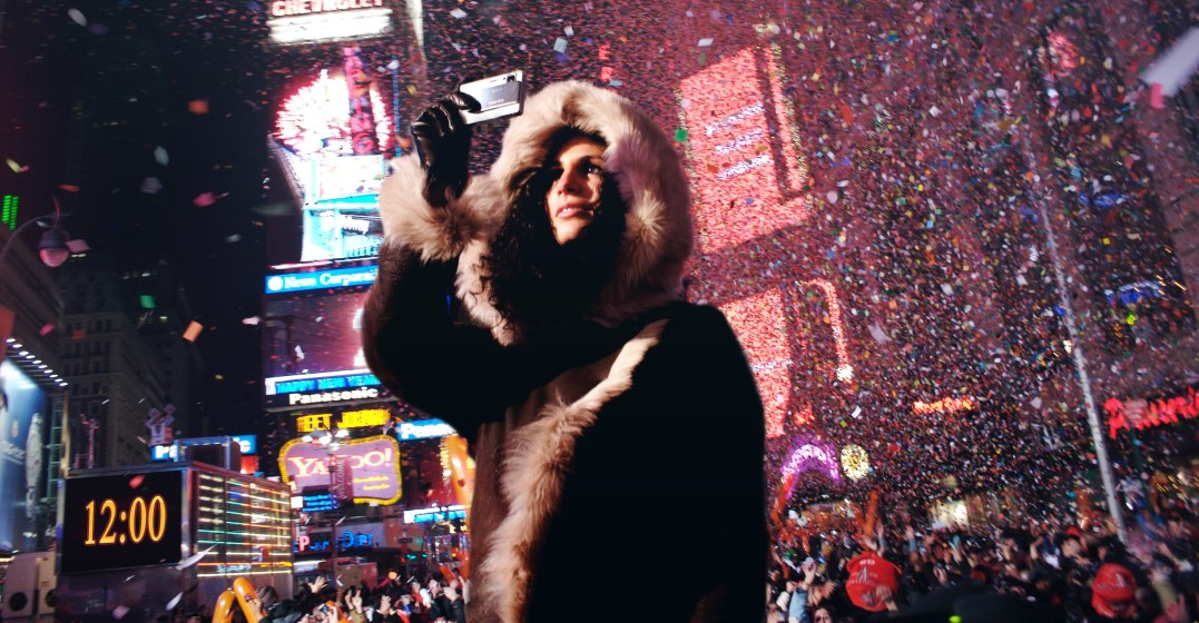 woman celebrating new year's eve in the US in times square