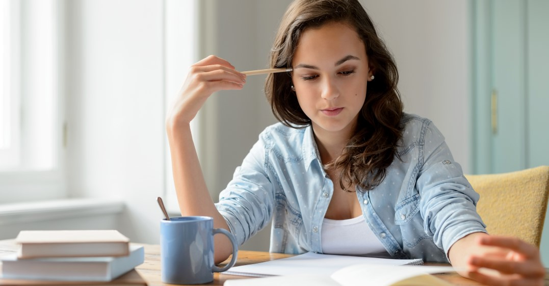 a woman studying How to remember articles in German