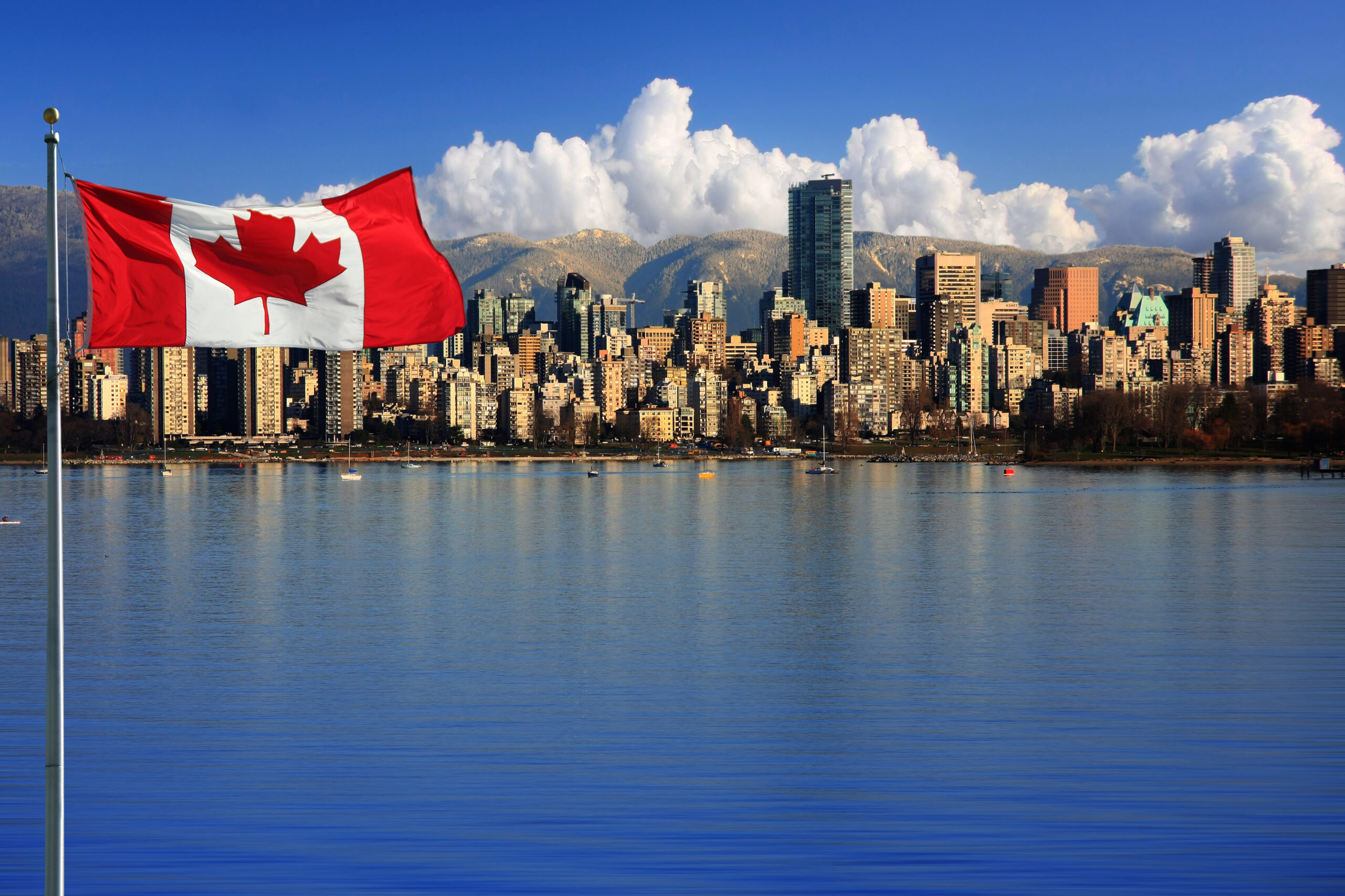 Differences between Canada and the US: Canadian flag in front of the Vancouver skyline