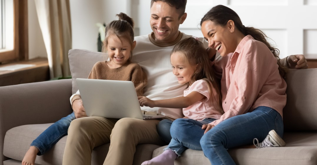 family looking online how to enrol kids in french schools