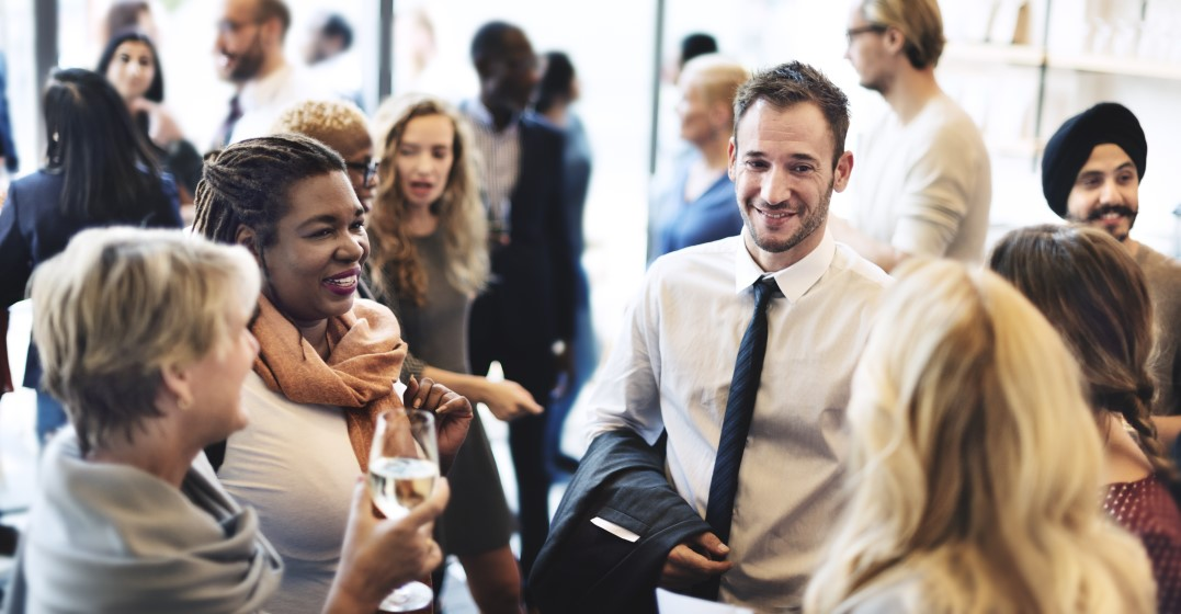 freelance workers at a networking event to get jobs