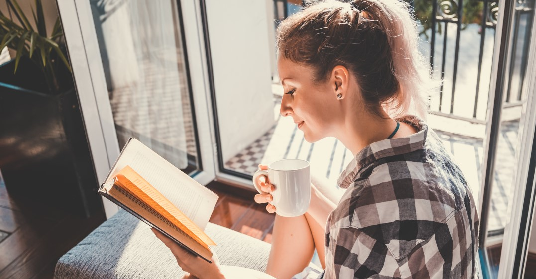 woman reading to advance her German vocabulary