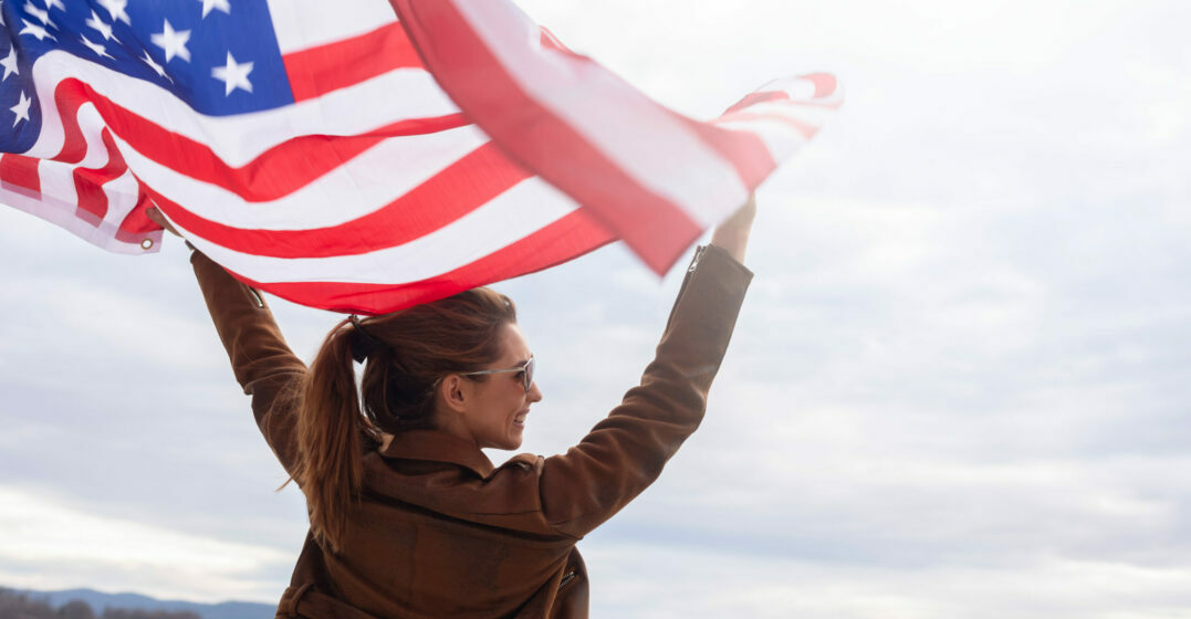 Woman holding american flag outdoor