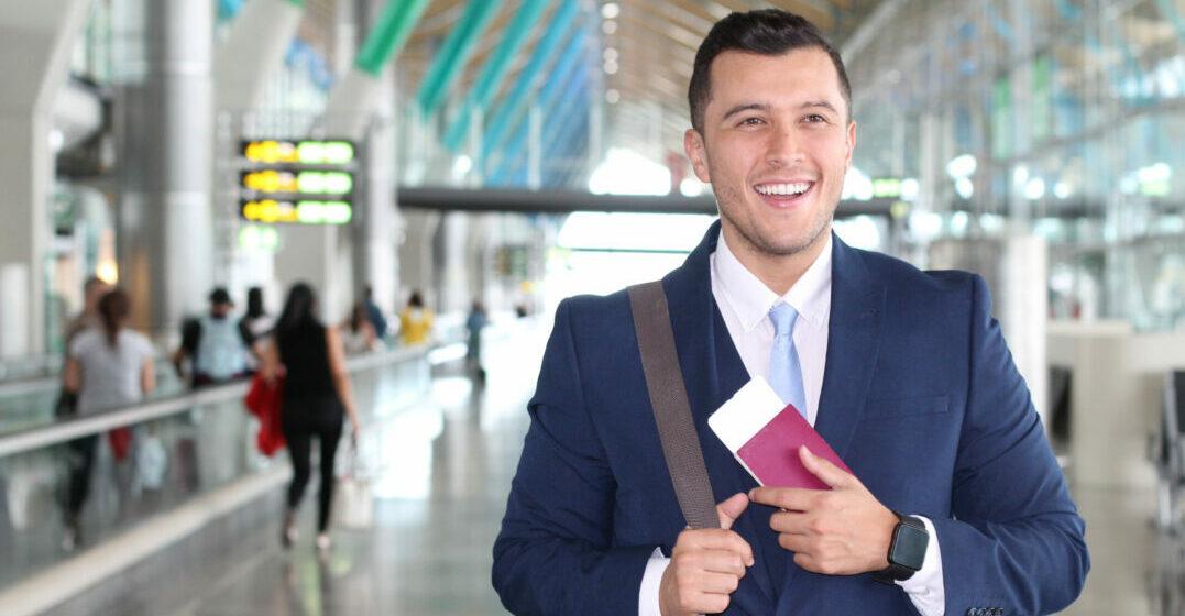 Businessman holding a passport in an airport